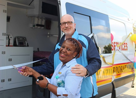 RSSC MD Nick Jackson(R) and medical practitioner Dr Ncamisile Ntiwane cut the ribbon to mark the official handover of the ambulance.